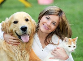 Dog bakery business owner with golden retriever dog and cat